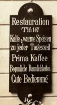 Udsnit af reklameskilt til værtshuset med tekst på tysk